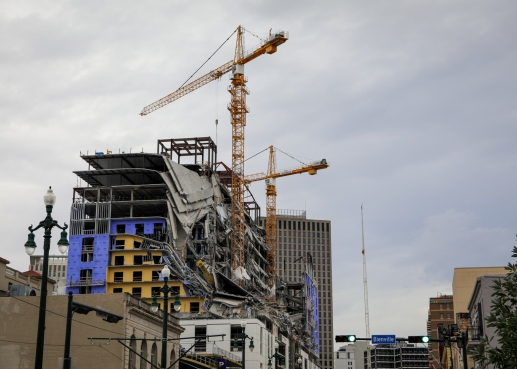 09 cranes atop collapsed hard rock