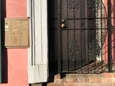26 french quarter postbox door gate shadow detail new orleans