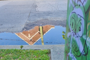 11 marigny church puddle reflection