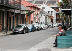 44 man on stoop french quarter reopening